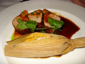 Spice-rubbed pork tenderloin, with a bourbon-ancho sauce and a sweet potato-pecan tamale.